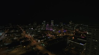DX0002_151_022 - 5.7K stock footage aerial video fly away from the city's skyline, reveal apartment high-rise at night, Downtown Milwaukee, Wisconsin