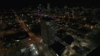 DX0002_151_023 - 5.7K stock footage aerial video approach and orbit an apartment high-rise at night, Downtown Milwaukee, Wisconsin