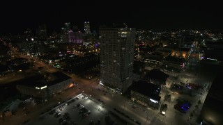 DX0002_151_024 - 5.7K stock footage aerial video flying away from an apartment high-rise at night, Downtown Milwaukee, Wisconsin