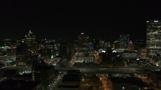 DX0002_151_027 - 5.7K stock footage aerial video of a stationary view of downtown buildings at night, Downtown Milwaukee, Wisconsin