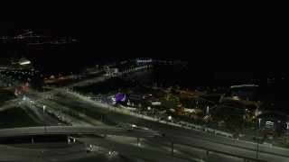DX0002_151_028 - 5.7K stock footage aerial video of a festival park near the waterfront museum at night, Downtown Milwaukee, Wisconsin