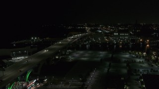 DX0002_151_029 - 5.7K stock footage aerial video of light traffic on Interstate 794 at night, Downtown Milwaukee, Wisconsin