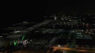 DX0002_151_030 - 5.7K stock footage aerial video of a view of light traffic on Interstate 794 at night, Downtown Milwaukee, Wisconsin