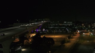 DX0002_151_032 - 5.7K stock footage aerial video approach light traffic on Interstate 794 at night, Downtown Milwaukee, Wisconsin