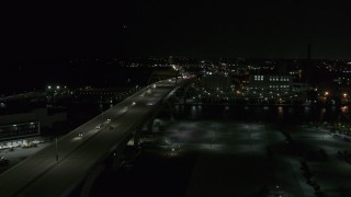 DX0002_151_033 - 5.7K stock footage aerial video of light traffic on I-794 freeway at night, Downtown Milwaukee, Wisconsin