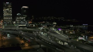 DX0002_151_034 - 5.7K stock footage aerial video of light traffic on I-794 freeway interchange at night, Downtown Milwaukee, Wisconsin