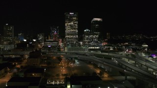 DX0002_151_036 - 5.7K stock footage aerial video of US Bank Center skyscraper by I-794 at night, Downtown Milwaukee, Wisconsin