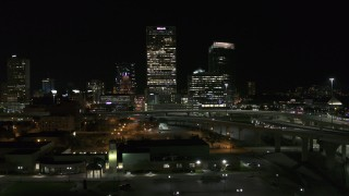 DX0002_151_037 - 5.7K stock footage aerial video of US Bank Center skyscraper seen during descent at night, Downtown Milwaukee, Wisconsin
