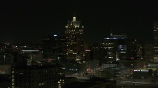DX0002_151_039 - 5.7K stock footage aerial video wide orbit of a skyscraper in Downtown Milwaukee, Wisconsin at night