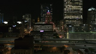 DX0002_151_040 - 5.7K stock footage aerial video of the Wisconsin Gas Building in Downtown Milwaukee, Wisconsin at night