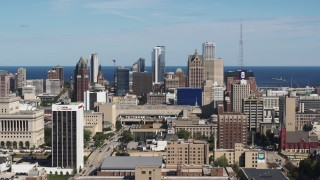 DX0002_152_002 - 5.7K stock footage aerial video ascend for a wide view of the city's skyline in Downtown Milwaukee, Wisconsin