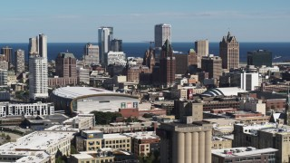 DX0002_152_015 - 5.7K stock footage aerial video wide view of the city's skyline, arena in Downtown Milwaukee, Wisconsin, seen from industrial buildings