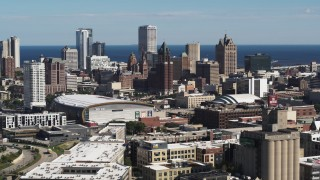 DX0002_152_017 - 5.7K stock footage aerial video of the city's skyline in Downtown Milwaukee, Wisconsin, ascend near industrial buildings