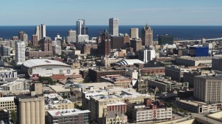 DX0002_152_023 - 5.7K stock footage aerial video a view of the city's skyline and arena in Downtown Milwaukee, Wisconsin, seen from I-43 freeway
