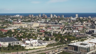 DX0002_152_025 - 5.7K stock footage aerial video of lakeside apartment buildings seen across the city in Milwaukee, Wisconsin