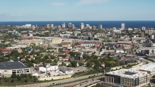 DX0002_152_027 - 5.7K stock footage aerial video of lakeside apartment buildings seen across the city while ascending in Milwaukee, Wisconsin