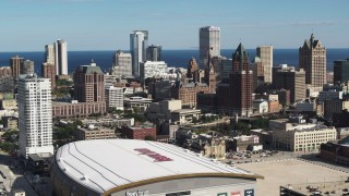 DX0002_152_033 - 5.7K stock footage aerial video approach the city's skyline and arena in Downtown Milwaukee, Wisconsin