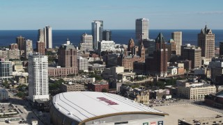 DX0002_152_035 - 5.7K stock footage aerial video reverse view of the city's skyline and arena in Downtown Milwaukee, Wisconsin
