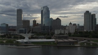 DX0002_154_002 - 5.7K stock footage aerial video of orbiting skyscrapers and the waterfront art museum in Downtown Milwaukee, Wisconsin