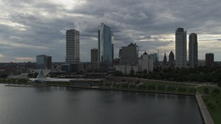 DX0002_154_003 - 5.7K stock footage aerial video reverse view of skyscrapers and art museum from Lake Michigan in Downtown Milwaukee, Wisconsin