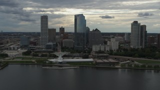 DX0002_154_010 - 5.7K stock footage aerial video orbit city skyline and the art museum by Lake Michigan in Downtown Milwaukee, Wisconsin