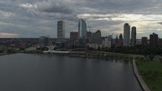 DX0002_154_011 - 5.7K stock footage aerial video reverse view of city skyline and the art museum by Lake Michigan in Downtown Milwaukee, Wisconsin