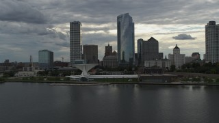 DX0002_154_017 - 5.7K stock footage aerial video stationary view of city's waterfront museum and skyline from Lake Michigan in Downtown Milwaukee, Wisconsin