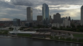 DX0002_154_020 - 5.7K stock footage aerial video fly away from and past skyscrapers and museum, Downtown Milwaukee, Wisconsin