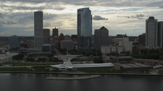 DX0002_154_023 - 5.7K stock footage aerial video flying away from tall skyscrapers and a museum, Downtown Milwaukee, Wisconsin