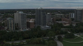 DX0002_154_029 - 5.7K stock footage aerial video of passing by a condominium high-rise in Milwaukee, Wisconsin
