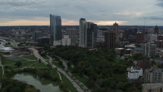 DX0002_154_038 - 5.7K stock footage aerial video stationary view of the city's skyline from pond at Veterans Park, Downtown Milwaukee, Wisconsin