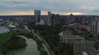DX0002_154_039 - 5.7K stock footage aerial video reverse view of the city's skyline from Veterans Park, Downtown Milwaukee, Wisconsin