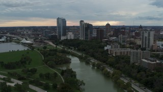 DX0002_154_040 - 5.7K stock footage aerial video of the city's skyline, seen seen while passing Veterans Park, Downtown Milwaukee, Wisconsin