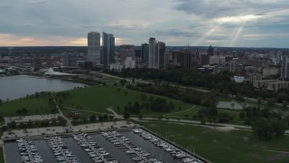 DX0002_154_041 - 5.7K stock footage aerial video reverse view of Veterans Park and skyline of Downtown Milwaukee, Wisconsin
