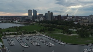 DX0002_154_042 - 5.7K stock footage aerial video descend and flyby Veterans Park and skyline of Downtown Milwaukee, Wisconsin