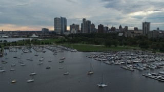 DX0002_154_043 - 5.7K stock footage aerial video of Veterans Park and skyline of Downtown Milwaukee, Wisconsin while descending by marina