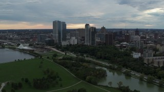 DX0002_154_045 - 5.7K stock footage aerial video flyby and away from Veterans Park and skyline of Downtown Milwaukee, Wisconsin