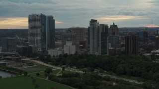 DX0002_155_002 - 5.7K stock footage aerial video of towering skyscrapers in the city's skyline at sunset, Downtown Milwaukee, Wisconsin