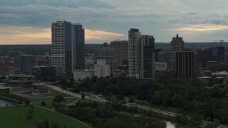 DX0002_155_003 - 5.7K stock footage aerial video approach the city's skyline at sunset, Downtown Milwaukee, Wisconsin