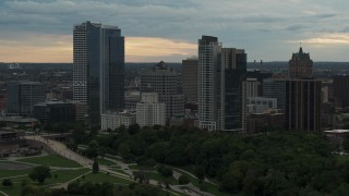 DX0002_155_007 - 5.7K stock footage aerial video flying past the city's skyline at sunset, Downtown Milwaukee, Wisconsin