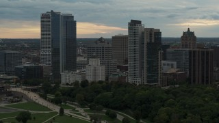 DX0002_155_008 - 5.7K stock footage aerial video flying away from the city's skyline at sunset, Downtown Milwaukee, Wisconsin