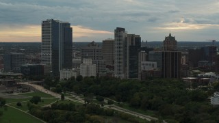 DX0002_155_010 - 5.7K stock footage aerial video flying by the tall skyscrapers the city's skyline at sunset, Downtown Milwaukee, Wisconsin
