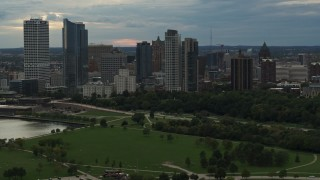 DX0002_155_012 - 5.7K stock footage aerial video of the city's skyline seen from green park at sunset, Downtown Milwaukee, Wisconsin