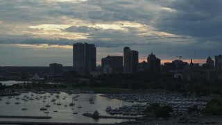 DX0002_155_016 - 5.7K stock footage aerial video the city's skyline seen while ascending near marina at sunset, Downtown Milwaukee, Wisconsin
