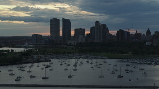DX0002_155_017 - 5.7K stock footage aerial video the city's skyline seen while flying by marina at sunset, Downtown Milwaukee, Wisconsin