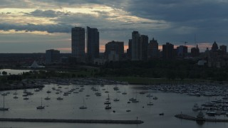 DX0002_155_018 - 5.7K stock footage aerial video the city's skyline seen while passing by marina at sunset, Downtown Milwaukee, Wisconsin