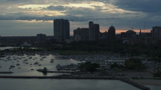 DX0002_155_019 - 5.7K stock footage aerial video the city's skyline seen from the marina at sunset, Downtown Milwaukee, Wisconsin