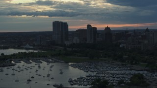 DX0002_155_021 - 5.7K stock footage aerial video of skyscrapers in the city's skyline seen while ascending past the marina at sunset, Downtown Milwaukee, Wisconsin