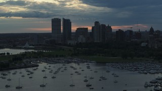 DX0002_155_022 - 5.7K stock footage aerial video of skyscrapers in the city's skyline seen while descending past the marina at sunset, Downtown Milwaukee, Wisconsin