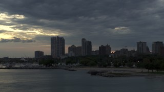 DX0002_155_024 - 5.7K stock footage aerial video of skyscrapers in the city's skyline seen while ascending past the marina at twilight, Downtown Milwaukee, Wisconsin